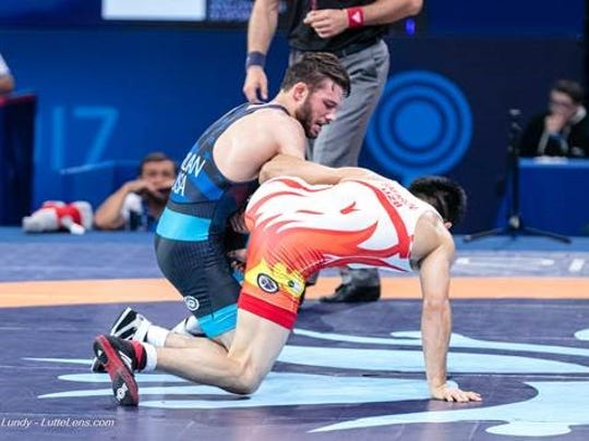Thomas Gilman attempts a takedown in a World Championships