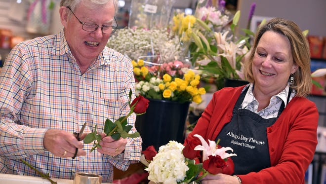 Tom and Nancy McIntyre, owners of A Daisy A Day florist in Highland Village, work on an arrangement Thursday at the flower shop.