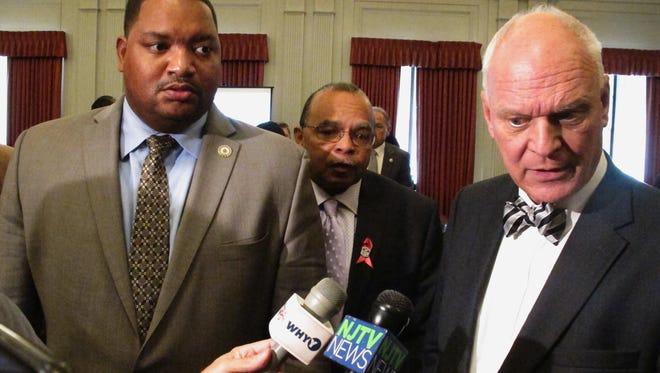 Atlantic City Councilmen Marty Small, from left, and William Marsh listen to Mayor Don Guardian speak to reporters in Trenton in October.