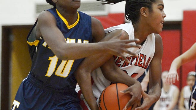 Penfield's Makaila Wilson, right, fights to keep the ball from Webster Thomas' Candaisy Crawford on Tuesday at Penfield. Penfield won 59-45.