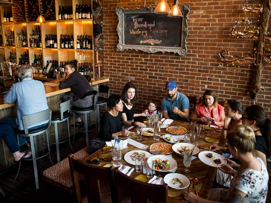 Guests dine during community hour at Lockeland Table, Tuesday, Nov. 1, 2016, in Nashville, Tenn. Community hour is from 4-6pm and a portion of the proceeds go to the Lockeland Design Center PTO.