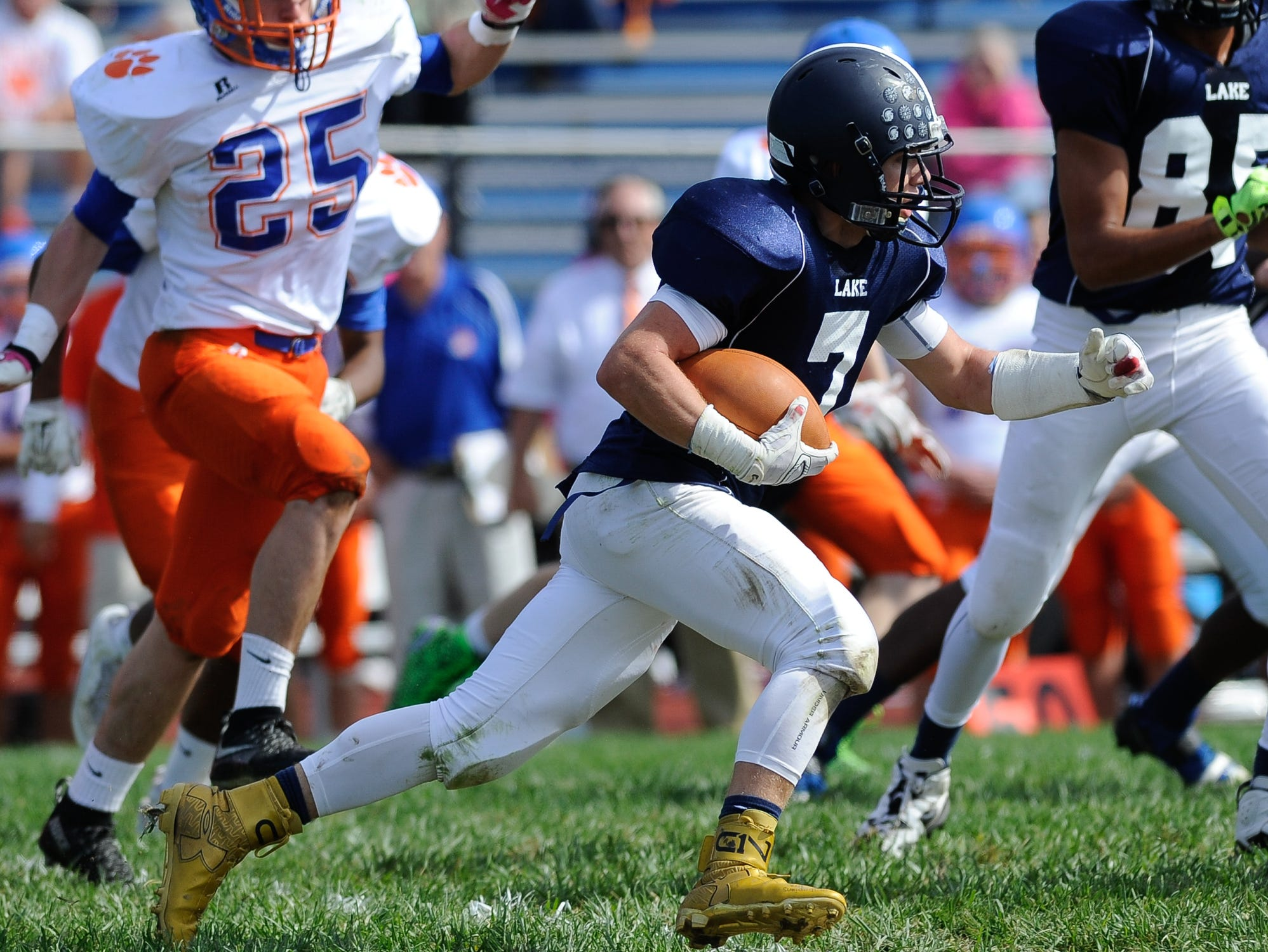 Lake Forest's #7 Ben Moore runs the ball in their 19-14 win over Delmar on Saturday at Lake Forest High School.