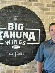 Matt Beeler inside his restaurant, Big Kahuna Wings