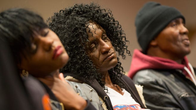 Family members of Freddie Gray, sister Fredricka Gray, left, mother Gloria Darden, center, and stepfather Richard Shipley listen during a news conference on April 27, 2015 after a day of unrest following the funeral of Freddie Gray in Baltimore.