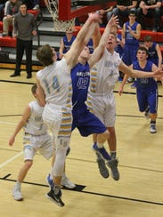 Montezuma's Clayton Krousie, 14, draws a foul at Lynnville-Sully's