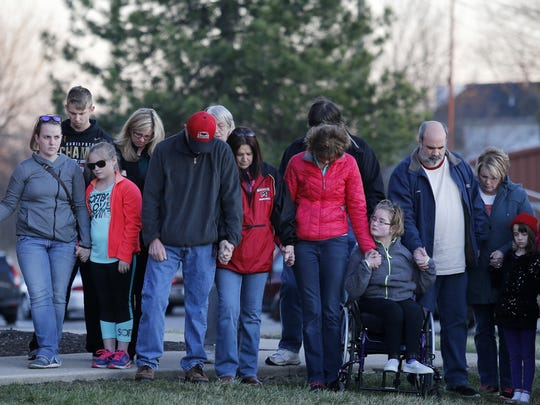 People gather for a vigil after the school shooting in Madison Township.