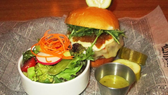 The bison burger served at The Horse & Plow was a juicy hand-packed burger topped with onion jam, garlic aioli, arugula, and pepper jack cheese.