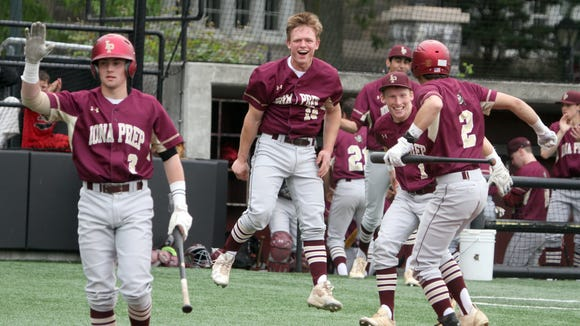Iona Prep celebrates after scoring two runs on a fielder's choice and an error in the fourth inning of a CHSAA semifinal playoff game at Fordham University Thursday. The Gaels defeated Fordham Prep 4-1.
