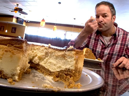 Chef Chris Brandl sample the cheesecake at the Four