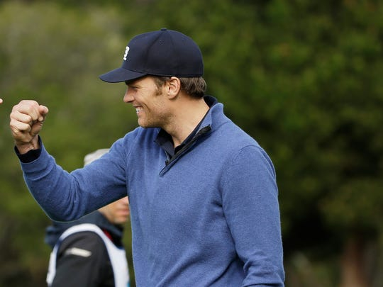 In a file photo from 2014, New England Patriots quarterback Tom Brady is shown at Pebble Beach Golf Links during the third round of the AT&T Pebble Beach Pro-Am.