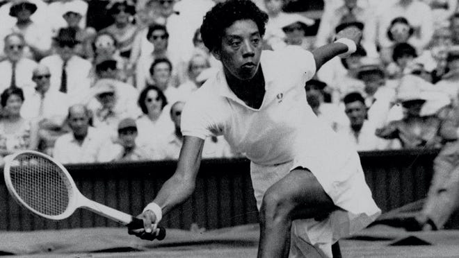 Althea Gibson during her history-making title match at Wimbledon on July 6, 1957, where she beat Darlene Hard to become the first African-American to win a championship at the tournament.