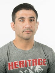 Junior Hernandez, Heritage High School girls wrestling