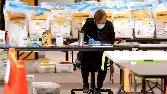 Stephanie Rushing, an election service coordinator   with the City of Milwaukee Election Commission, counts ballots as workers were processing absentee ballots cast during the April primary on April 13, 2020, in Milwaukee.