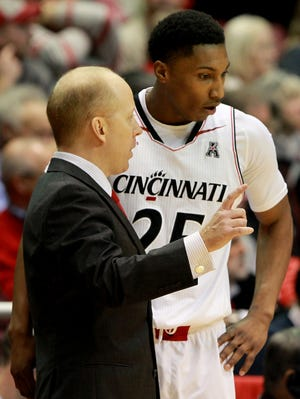 Cincinnati head coach Mick Cronin talks with guard Kevin Johnson last season.