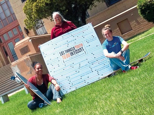 """""""101 Things for Youth to Do in Grant County"""" kicks off on Saturday from noon to 4 p.m. on the Grant County Courthouse lawn with 60 businesses participating in the Youth Substance Abuse Prevention Coalition's summer challenge. YSAPC Coordinator Razanna Robinson-Thomas, from left, Health Council coordinator Chris DeBolt and YSAPC Assistant Caitlyn Zollinger show off the skateboards that are some of the many prizes available for youth to win by participating."""