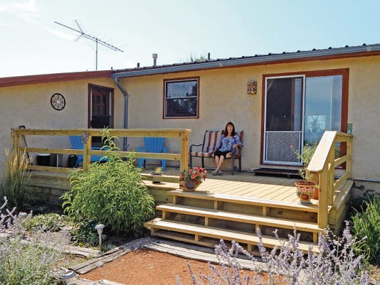 Lisa Maue — Ruidoso News   Patricia Young on her deck.
