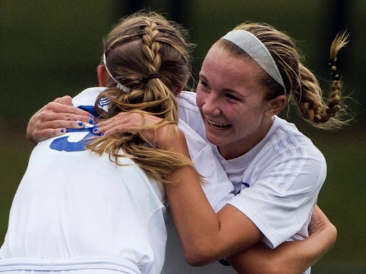 Cedar Crest's Sam Gerhart (right) hugs Alex Burrows after scoring her first goal Saturday in the 2015 Blue-Gray Cup, a 3-0 Falcons victory.