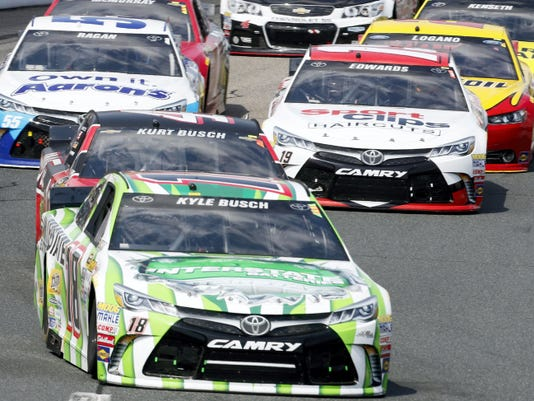 Kyle Busch (18) leads his brother, Kurt, during Sunday's Sprint Cup race at New Hampshire Motor Speedway in Loudon, N.H. Kyle Busch won for the second straight weekend and the third time in the last four Sprint Cup races