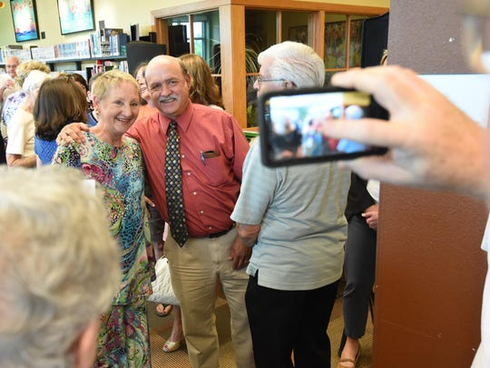 Gwen Khayat has a picture taken with Baxter County Judge Mickey Pendergrass during her retirement ceremony on Tuesday.