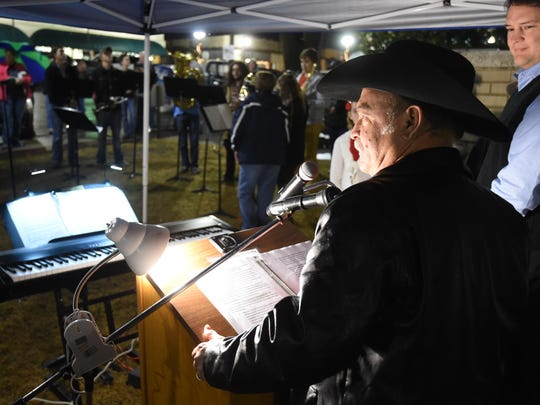 Baxter County Judge Mickey Pendergrass prepares to address the crowd during the annual lighting of the Christmas tree in downtown Mountain Home last December. The Christmas tree is placed with the controversial nativity scene on the courthouse lawn.