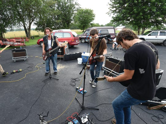 Coyote Union rolls through a 12-song set of original compositions during an outdoor rehearsal in Mountain Home.