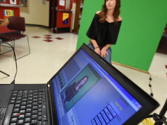 Bryan Johnson captures a Norfork student's picture on his laptop computer.