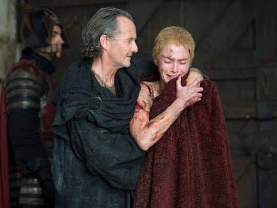 "Anton Lesser and Lena Headey in ""Game of Thrones."""