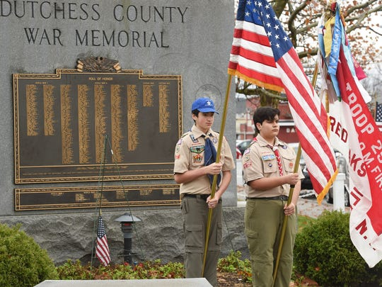 Boy Scouts from Troop 25 stand with the colors during the 2015 Dutchess County Veterans Day ceremony at the Dutchess County War Memorial in the Town of Poughkeepsie.