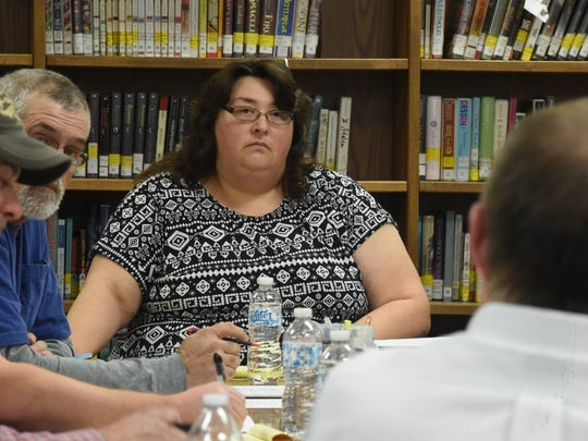 Cotter School Board President Reneta Dewey listens to Superintendent Don Sharp during a special meeting Thursday, Jan. 14, 2016.