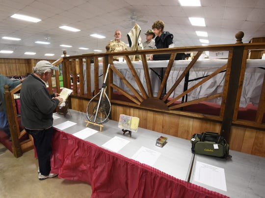 Organizers set up items that will be auctioned during