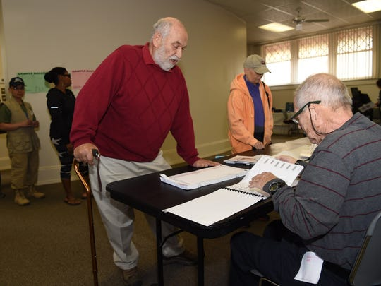 Constantine Kazolias signs in with election inspector, Mel Berkwit for Tuesday's primary election at the Poughkeepsie Library in the City of Poughkeepsie on Tuesday.