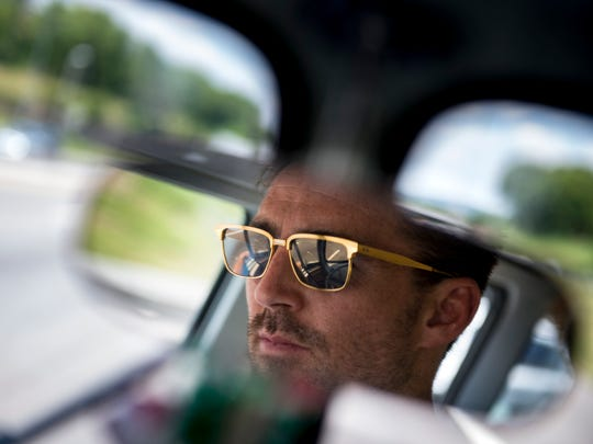 Jake Owen is seen reflected in the rearview mirror as he drives his vintage Volkswagen bus July 18, 2016, in Nashville.