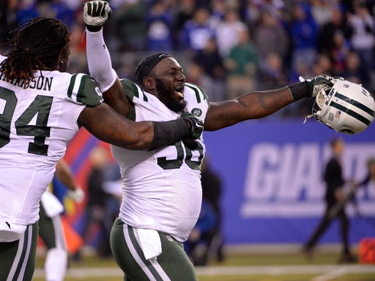 New York Jets defensive end Muhammad Wilkerson (96) and nose tackle Damon Harrison (94), shown here celebrating beating the New York Giants in overtime last season, lead a potent defense against the Colts.