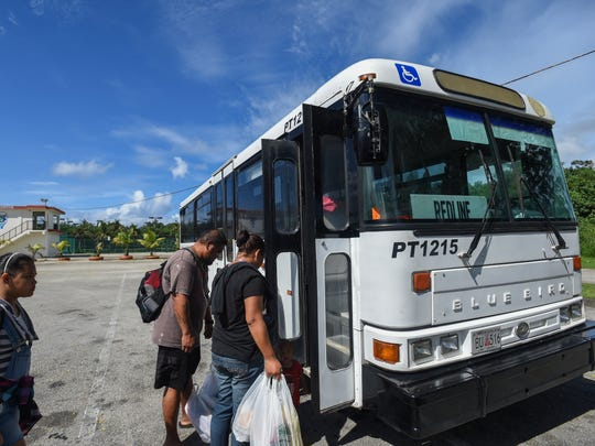 In this Oct.1 file photo, passengers board a bus at the Guam Regional Transit Authority bus stop in Hagåtña Pool. The agency announced it has contracted Kloppenburg Enterprises to be its long-term bus service provider.