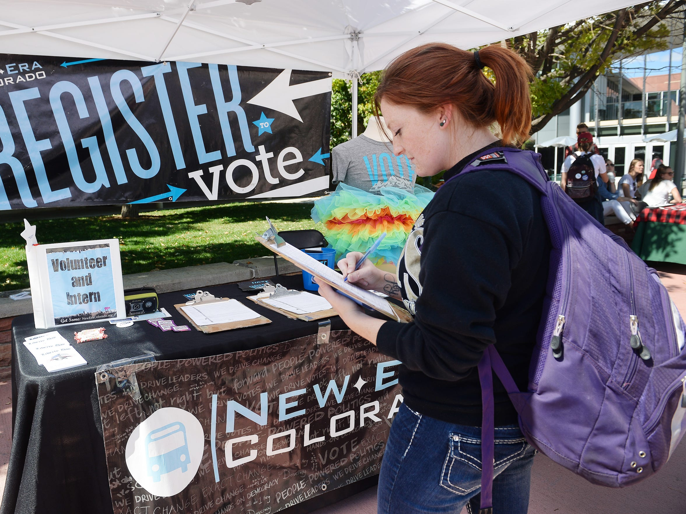 Sarah Shinn updates her voter registration at Colorado