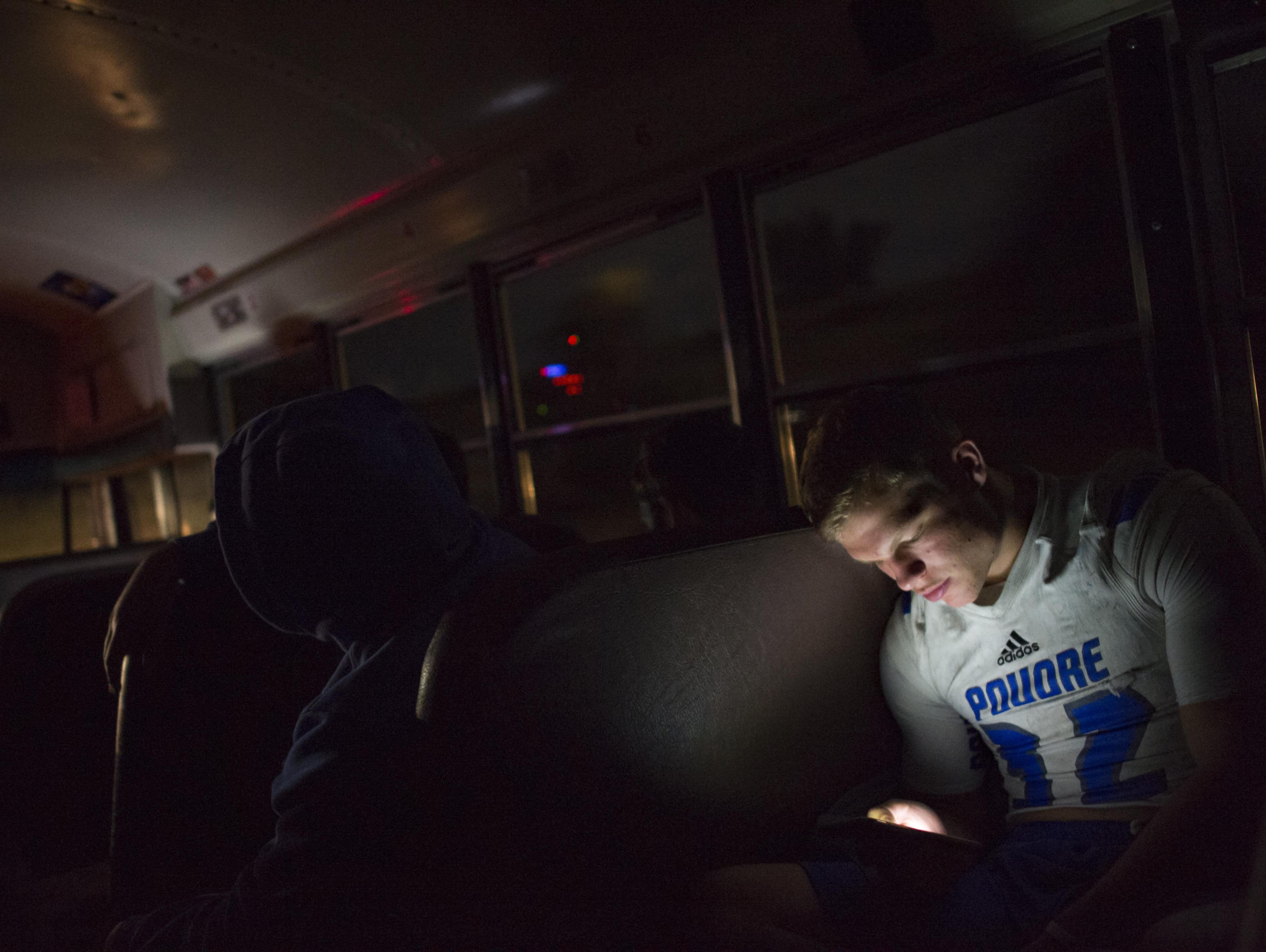11:02 p.m. - Poudre High School football player JT Erickson looks at his cell phone on the bus ride home from a game against Legend High School in Parker, a nearly 90-mile trip, Thursday, October 13, 2016.