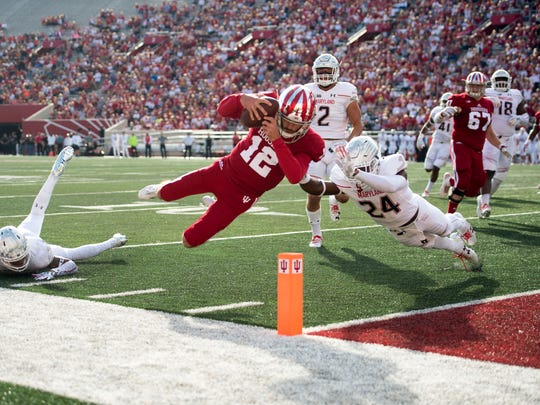 Indiana Hoosiers quarterback Zander Diamont (12) dives into the end zone with the ball for a touchdown during the first quarter of the game at Memorial Stadium.