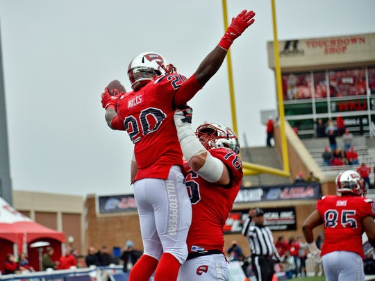 Dec 3, 2016; Bowling Green, KY, USA; Western Kentucky Hilltoppers running back Anthony Wales (20) celebrates scoring a touchdown against the Louisiana Tech Bulldogs with Hilltoppers offensive lineman Forrest Lamp (76) during the first half of the CUSA championship game at Houchens Industries-L.T. Smith Stadium. Mandatory Credit: Jim Brown-USA TODAY Sports