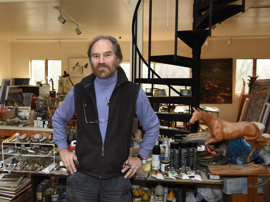 Murray Zimiles, an artist based out of Millerton, stands