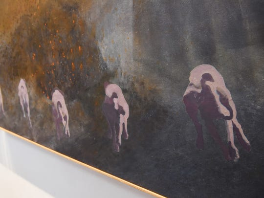 A closeup of Murray Zimiles' triptych centered around