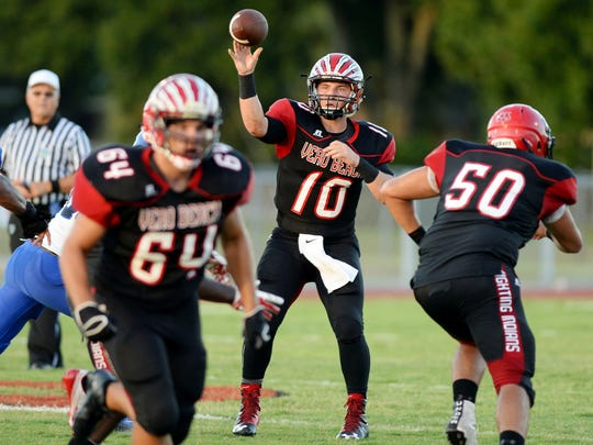 Vero Beach High School quarterback Mike Dean (10) played a key role in the Fighting Indians 11-1 season.