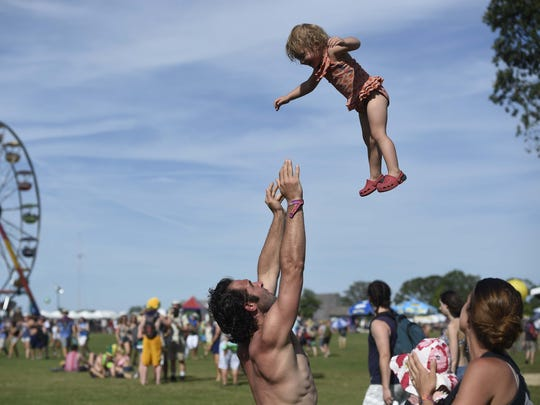 Darren Nixon of Maryland plays with his daughter Violet,