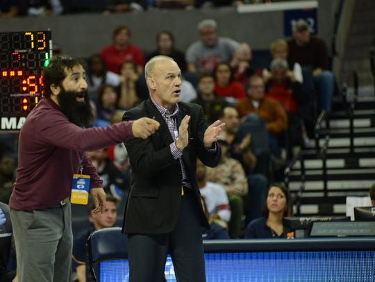 Virginia Tech coach Kevin Dresser, right, accepted
