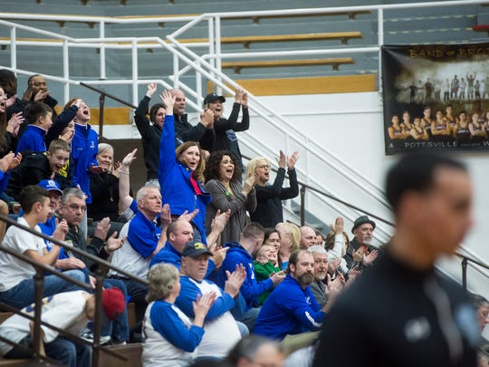 Spring Grove fans react after the Rockets built an early lead against East Stroudsburg North during the first quarter of the PIAA playoff game Friday at Martz Hall in Pottsville.