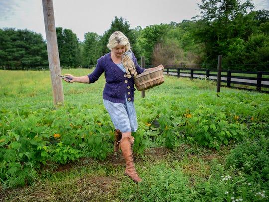 Samantha Lamb harvests vegetables from her garden at