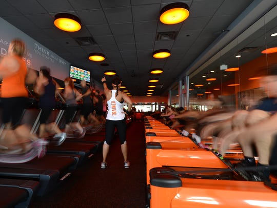 Exercisers in action at Orangetheory.