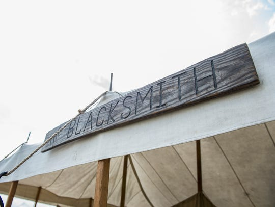 "A tent called ""The Blacksmith"" sells an assortment"