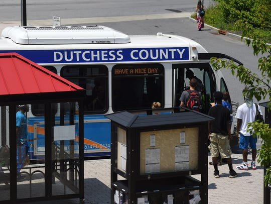 People board a bus at the City of Poughkeepsie bus