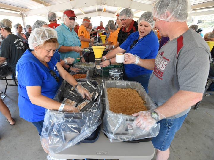 Volunteers pack meals during the 2017 Bridge Bash.
