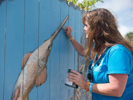 "Katie Carlsson, of Palm City, is creating an environmental mural for the Mural Project at Ground Floor Farm along Martin Luther King Boulevard in Stuart. ""I grew up fishing in these waters,"" Carlsson said, who is a third generation Floridian. The project features professional, amateur and student artists."